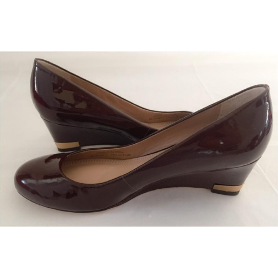 394e98e2dbbd Tory Burch Dark Brown Astoria Patent Leather Wedges Size US 6.5 .