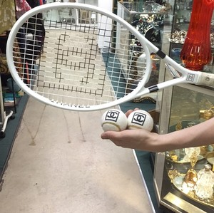 Chanel Chanel White and black Tennis Racket with two Chanel balls.