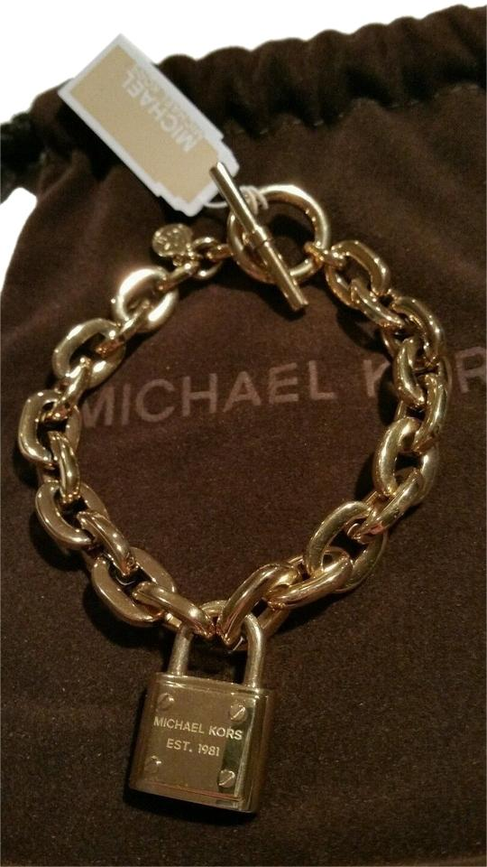 0266f11a06dad Michael Kors Gold Tone Mk Logo Padlock Toggle Chain Link New with Tags  Bracelet
