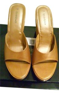 bebe GOLD LEATHER SLIP ON WEDGES Wedges