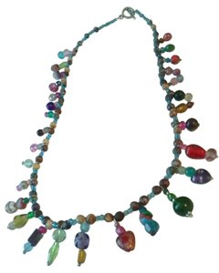 tons of tiny glass charms around beaded necklace