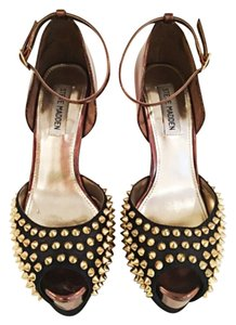 Steve Madden Black satin, bronze, and gold spikes. Platforms