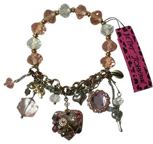 Betsey Johnson Betsey Johnson rose gold, silver, and gold, beads in pinks, smoky and clear bracelet
