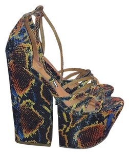 Jeffrey Campbell Blue, red, yellow, and black Platforms
