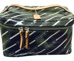 Coach Coach Cosmetic Case Travel Pouch Leather and vinyl Bag Black and white with Coach logo in white print all over back with leather handle and tag