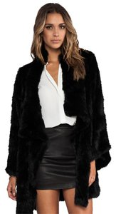 Elizabeth and James Victoria Beckham Chanel Nicholas H Brand Burberry Fur Coat