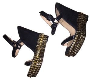 Christian Louboutin Black and gold Wedges