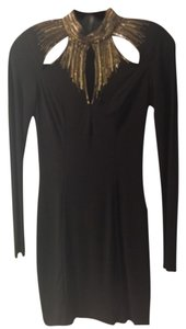 bebe short dress Black and gold on Tradesy