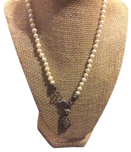Other Pearl necklace with two enhancers