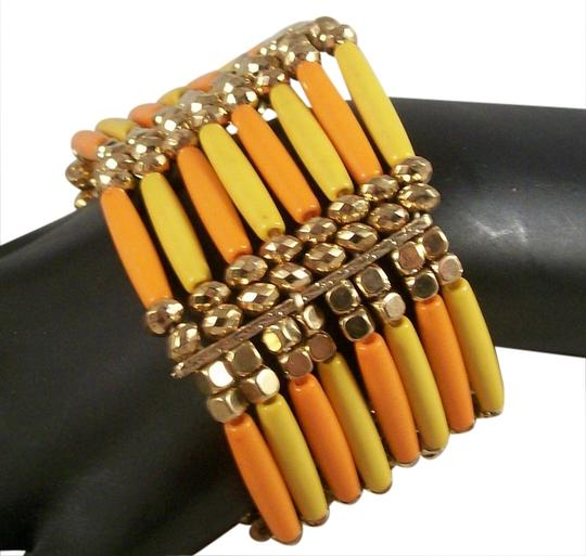 Preload https://item1.tradesy.com/images/bogot-orange-and-yellow-chunky-stretch-bracelet-with-gold-accents-1011285-0-0.jpg?width=440&height=440