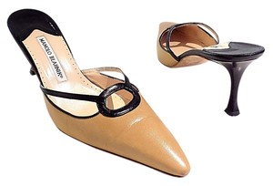 Manolo Blahnik black. brown Mules