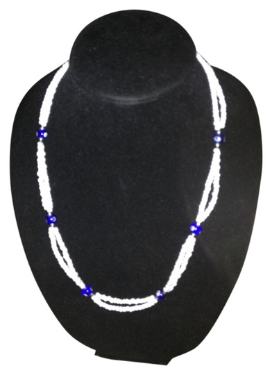 Preload https://item1.tradesy.com/images/unknown-white-blue-bead-eye-double-strand-necklace-1016450-0-0.jpg?width=440&height=440