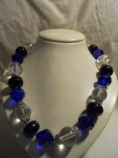Preload https://img-static.tradesy.com/item/101648/les-bernard-blue-black-and-clear-acrylic-beads-chunky-necklace-0-0-540-540.jpg