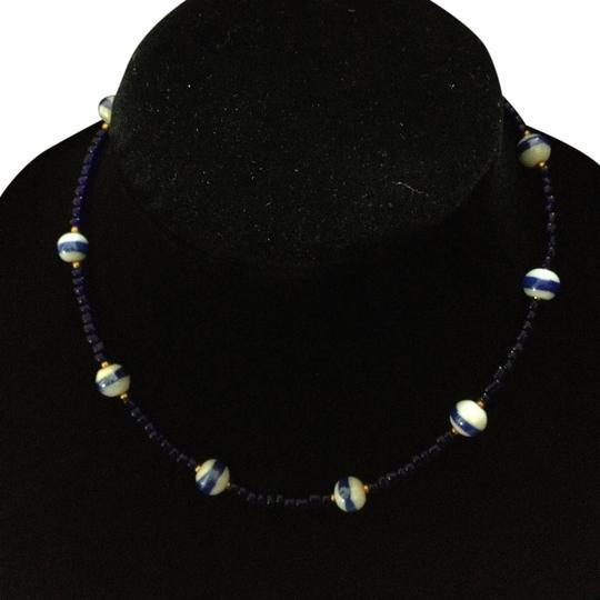 Preload https://item5.tradesy.com/images/unknown-vintage-white-cobalt-striped-gold-tone-bead-short-necklace-1016579-0-0.jpg?width=440&height=440