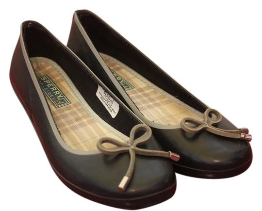 Preload https://item1.tradesy.com/images/sperry-black-top-siders-waterproof-rubber-with-suede-bow-flats-size-us-65-1017035-0-0.jpg?width=440&height=440