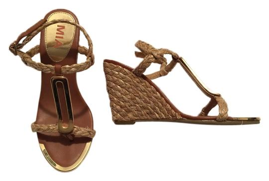 Preload https://item3.tradesy.com/images/mia-tan-and-gold-summer-strappy-wedges-sandals-size-us-6-regular-m-b-10180747-0-1.jpg?width=440&height=440