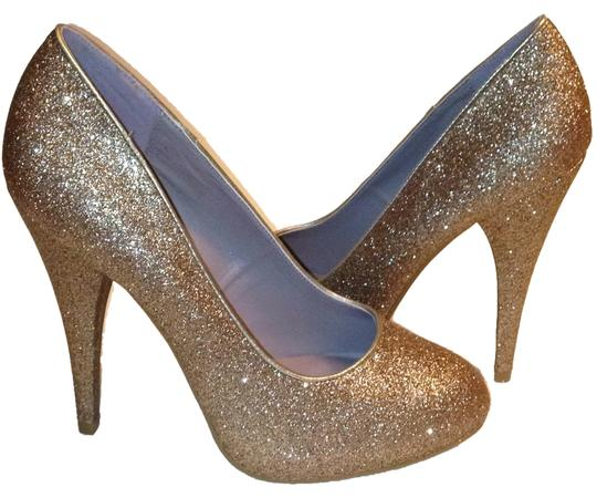Preload https://item1.tradesy.com/images/xappeal-gold-glitter-round-toe-formal-pumps-size-us-65-regular-m-b-10183060-0-1.jpg?width=440&height=440
