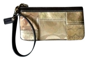 Coach Leather Wristlet in Gold with Brown Trim