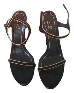 Gucci Black and Gold Platforms
