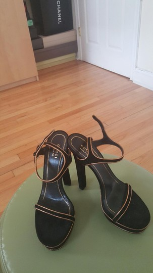 Gucci Black and Gold Platforms Image 1