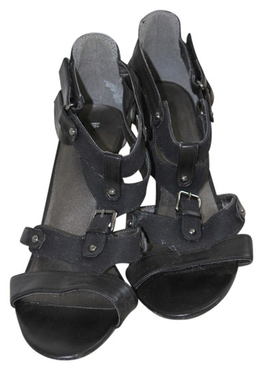 Preload https://item1.tradesy.com/images/mossimo-supply-co-black-very-dark-navy-denim-velcro-buckle-heel-leather-faux-leather-sandals-size-us-1020125-0-0.jpg?width=440&height=440