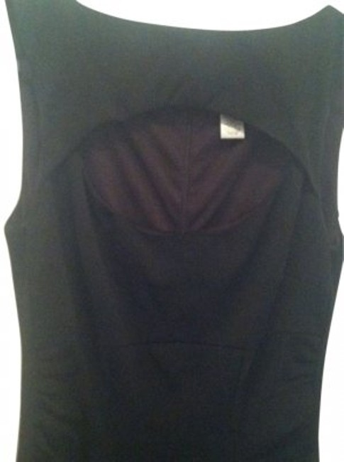 Preload https://item4.tradesy.com/images/cache-black-little-w-peek-a-boo-low-cut-above-knee-night-out-dress-size-6-s-10203-0-0.jpg?width=400&height=650
