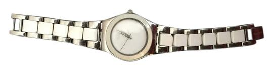 Preload https://item4.tradesy.com/images/swatch-white-and-silver-watch-10223803-0-1.jpg?width=440&height=440