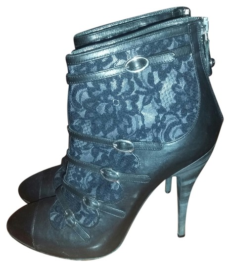 Preload https://img-static.tradesy.com/item/10232236/roberto-cavalli-black-lace-bootsbooties-size-us-7-0-1-540-540.jpg