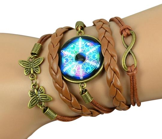 Preload https://item2.tradesy.com/images/multicolored-galaxy-milky-way-cabochon-leather-braided-wrap-bracelet-10234366-0-1.jpg?width=440&height=440
