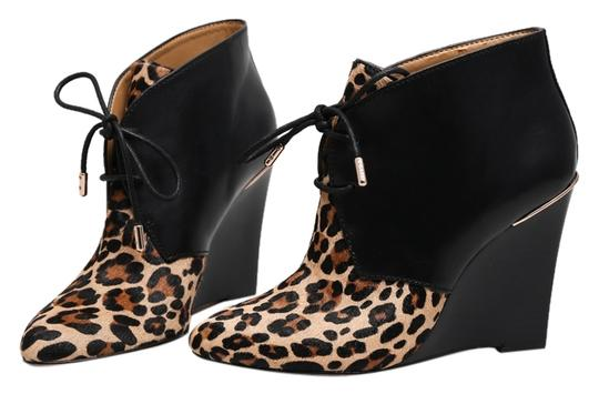 Preload https://item5.tradesy.com/images/coach-black-mercy-leatherleopard-calf-hair-ankle-boots-wedges-size-us-6-regular-m-b-10242019-0-1.jpg?width=440&height=440