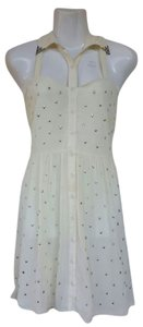 Millau short dress Beige Stars Metallic Embellishments Cut Out on Tradesy