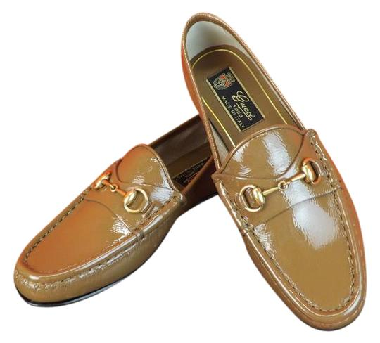 Preload https://item4.tradesy.com/images/gucci-acero-horsebit-light-brown-frame-1953-patent-leather-gold-loafers-4-flats-size-eu-34-approx-us-10252963-0-3.jpg?width=440&height=440