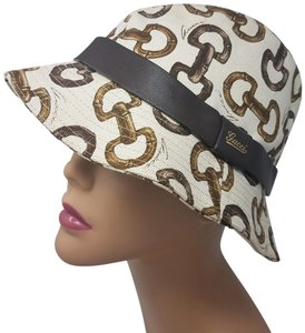 Gucci Brown, ivory monogram Gucci bamboo horsebit bucket hat
