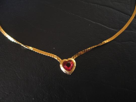 Preload https://item5.tradesy.com/images/red-stone-encased-in-gold-heart-frame-costume-18-chain-necklace-10261849-0-1.jpg?width=440&height=440