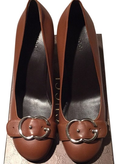 Preload https://item2.tradesy.com/images/gucci-brown-sachalin-det-with-buckle-pumps-size-us-95-regular-m-b-10265116-0-1.jpg?width=440&height=440