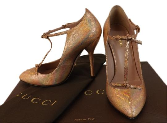 Preload https://item2.tradesy.com/images/gucci-salmon-beverly-cracked-leather-t-strap-knotted-8-pumps-size-eu-385-approx-us-85-regular-m-b-10272166-0-1.jpg?width=440&height=440