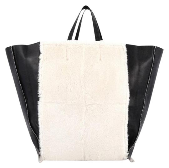Preload https://item5.tradesy.com/images/celine-vertical-cabas-black-and-white-leather-shearling-tote-1027814-0-6.jpg?width=440&height=440