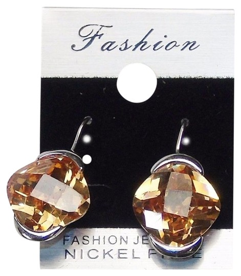 Preload https://img-static.tradesy.com/item/10280713/gold-fashion-drop-silver-tone-with-amber-color-gemstone-earrings-0-1-540-540.jpg