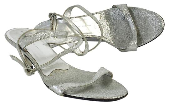 Preload https://item2.tradesy.com/images/giuseppe-zanotti-silver-sparkle-strappy-heels-sandals-size-us-7-10304401-0-1.jpg?width=440&height=440
