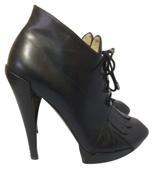 Preload https://item1.tradesy.com/images/nicholas-kirkwood-black-leather-kiltie-lace-up-bootsbooties-size-us-65-regular-m-b-10312195-0-1.jpg?width=440&height=440