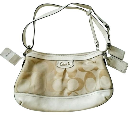 Preload https://item2.tradesy.com/images/coach-tancream-cross-body-bag-10315336-0-1.jpg?width=440&height=440