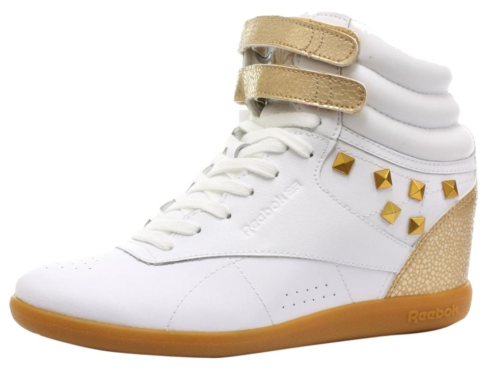 ddfe6a423a Reebok White and Gold New Womens Hi Int Wedge Trainers Classic Top Sneakers  Size US 7 Regular (M, B)