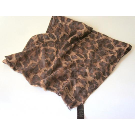 Preload https://item3.tradesy.com/images/coach-ocelot-animal-print-brownblack-print-long-scarfwrap-10338097-0-0.jpg?width=440&height=440