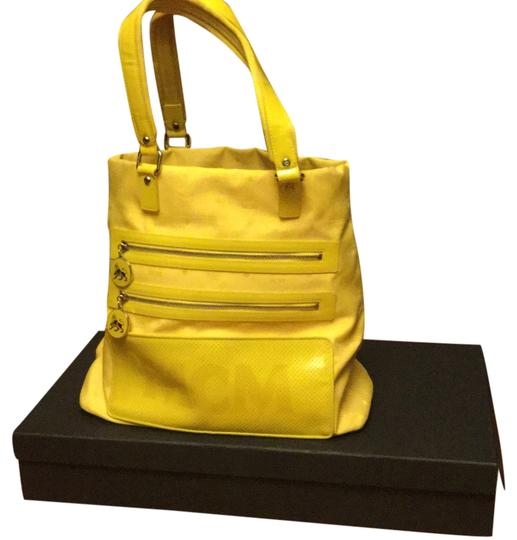 Preload https://img-static.tradesy.com/item/10353040/mcm-yellow-nylon-and-patent-leather-tote-0-1-540-540.jpg