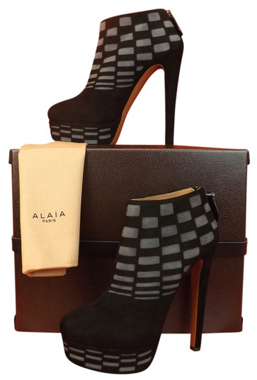 Preload https://item2.tradesy.com/images/alaia-blackgray-two-tone-suede-laser-cut-platform-zip-ankle-bootsbooties-size-eu-395-approx-us-95-re-10366216-0-1.jpg?width=440&height=440