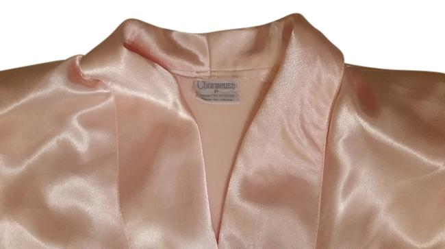 Preload https://img-static.tradesy.com/item/10370008/peach-night-out-top-size-6-s-0-2-650-650.jpg