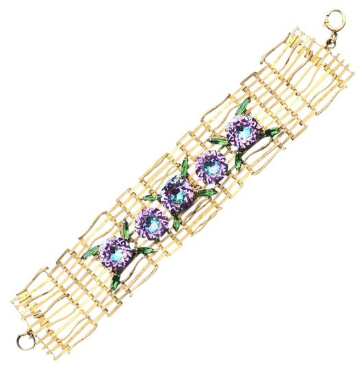 Preload https://img-static.tradesy.com/item/10378957/brass-with-lilac-rhinestones-bracelet-0-3-540-540.jpg