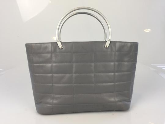 Preload https://item2.tradesy.com/images/chanel-quilted-gray-leather-tote-1038586-0-3.jpg?width=440&height=440