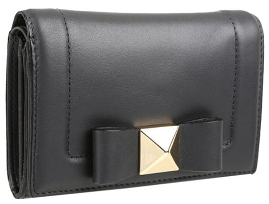 Preload https://item5.tradesy.com/images/kate-spade-new-york-bow-terrace-wallet-black-leather-clutch-1039734-0-0.jpg?width=440&height=440
