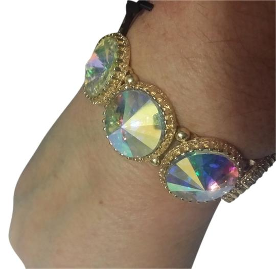 Preload https://img-static.tradesy.com/item/10398025/golden-multy-over-sized-iridescent-hypoallergenic-bracelet-0-12-540-540.jpg
